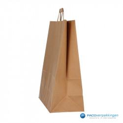 Papieren draagtassen - Bruin Kraft - Platte handgreep - Zijaanzicht voor