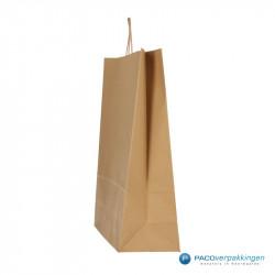 Papieren draagtassen - Bruin Kraft - Gedraaide handgreep - Zijaanzicht